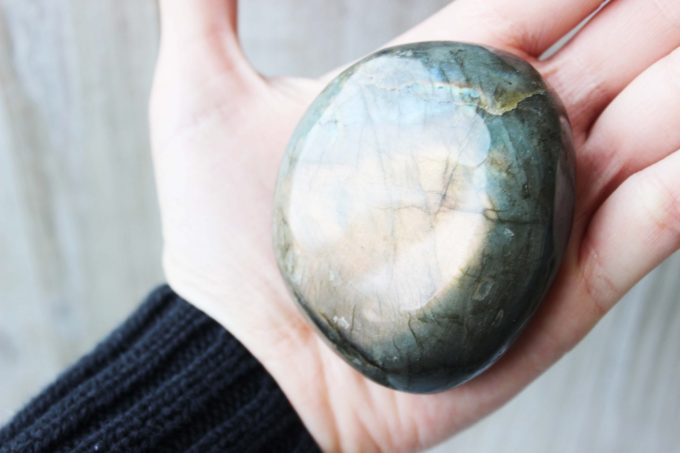 Natural labradorite from Madagascar polished into a palm stone