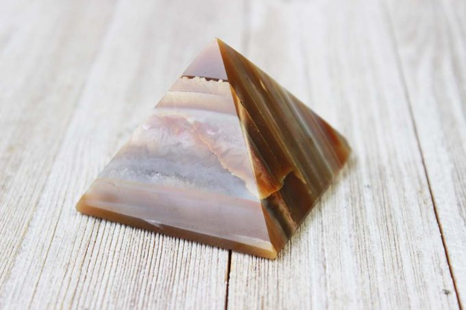 Natural agate crystal from Brazil polished into a pyramid shape